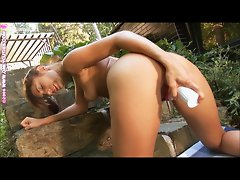Nude teen dildoing outdoor