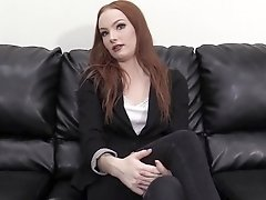 Redhead Layla gets bent over and fucked hard on the casting table