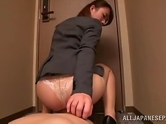 Charming Japanese office lady in high heels gives great blowjob