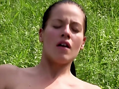 Skinny chick Evelyn enjoys rubbing her shaved pussy outdoors