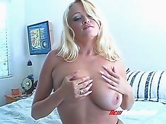 Blonde hottie in black lingerie dildoes her delicious twat