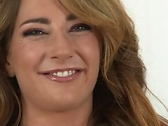 Cute cougar in white lingerie is all smiles during her interview