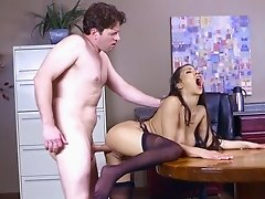 Busty secretary loves to spin boss's dick in her office