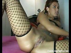 Brunette fucking her two holes hard(1)
