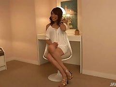 Classy appealing babe Aya Sakuraba posing for camera teasingly