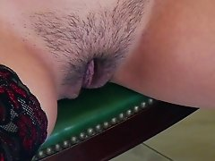 Curvy pornstar in sexy stockings shows off her hairy pussy close up