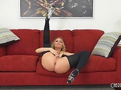 Curvy Britney Amber kneels down on the bed for the hard pounding