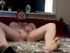 Hot redhead twink squeezes his long pole in his bedroom