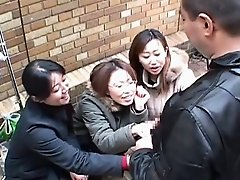 Japanese women tease man in public via handjob Subtitled
