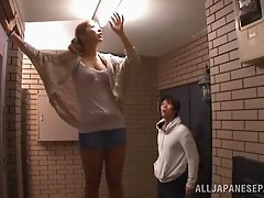 A spying guy look up her miniskirt for an upskirt view