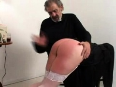 Naughty nun in stockings gets spanked hard by the priest