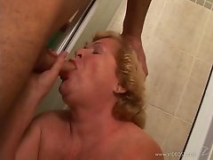 Blonde granny Alice blows and enjoys sex in the side-by-side position