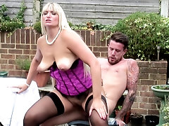 Mature blonde British MILF Lucy B. gets a cock hard with her tits