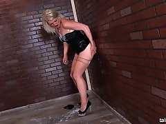 After a hot blowjob through a glory-hole Dona gets drenched with cum