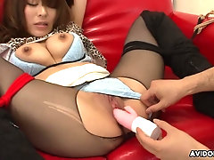 Rope bound Asian girl with a toy inside her pussy