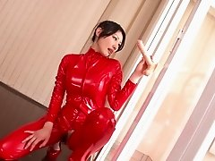 Adorable Japanese babe in a leather body suit getting her hairy pussy drilled with a vibrator