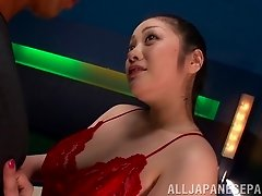 Red satin slip on a sexy cocksucking Japanese girl with curves
