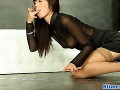 slim brunette rubs her pussy on a rubber toy