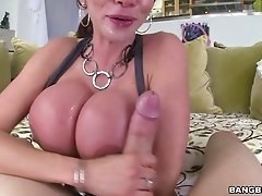 Dark haired filthy mommy with fake jugs performs solid deep throat on POV cam