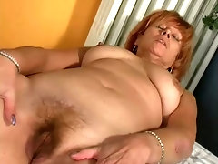 Dirty red haired lady is so into petting her own mature cunt