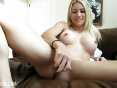 Stunning Blond Creams Her Pussy With A Glass Dildo
