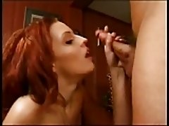 Redhead with a nice rack blows a big hard cock