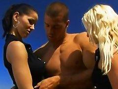 Angel Dark and Carla Cox enjoy ardent FFM threesome sex outdoors