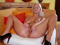 Bug assed blond cutie pleasures her fanny with sex toy and fingers