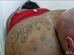 Busty chic with tattoos on her butts gets screwed doggystyle in a close up shoot