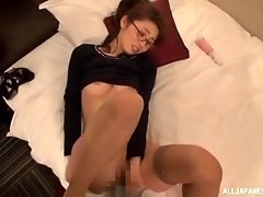 Shy Japanese brunette babe sucks on a dildo before fucking
