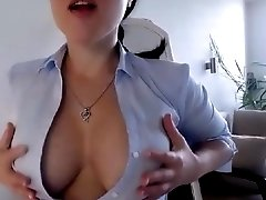 Russian brunette babe showing her natural big boobs in front of the webcam