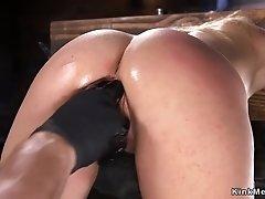 Blonde in device bondage pussy beaten