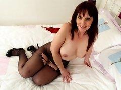 British milf Beau Diamonds stuffs her fanny with a dildo