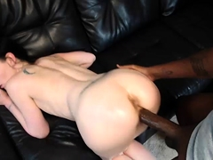 Sexy brunette has a black dick invading her cunt from behind