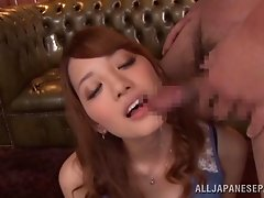 Pretty Shion Utsunomi gets oral gangbanged during a bukkake party