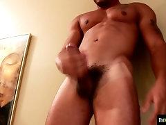 Ripped black amateur tugging hard cock