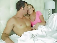 Gorgeous long-haired chick having sex with her partner on the bed