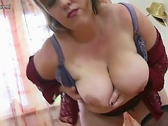 Mother sucking her saggy tits and gettin off