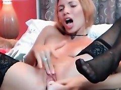 Babe strokes a monster dildo