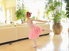 Pretty ballerina rubs her pussy while doing her stretches