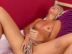 Nasty blond girl masturbates with a vaginal speculum