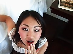 Asian gets on her knees and blows a guy until he cums in her mouth