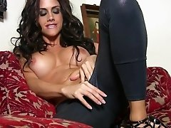 Curly-haired brunette is drilling her puss