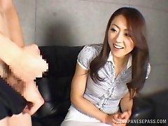 Charming Asian dame in miniskirt pose lovely then giving her guy handjob