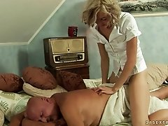 A blonde chick fucks an older guy then she pisses all over him