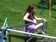Redhead in a tiny skirt does some fun flashing on the playground