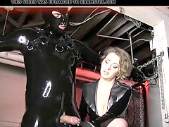 This MILF ties her slave up and strokes his cock