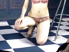 sweet Asian girl spreads her legs to show her haired pussy with a toy inside