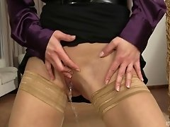 Pissing on classy Cayla Lyons who is pleasuring his cock on her knees