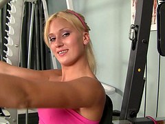 Brilliant blonde with natural tits giving her guy blowjob in the gym